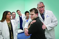 Professor with patient and students