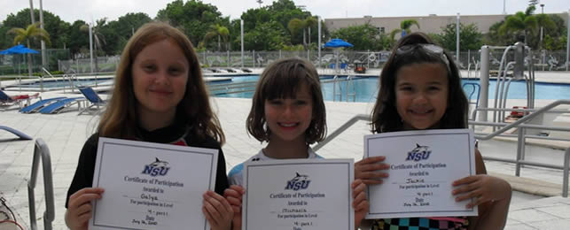 Children holding their swim certificates