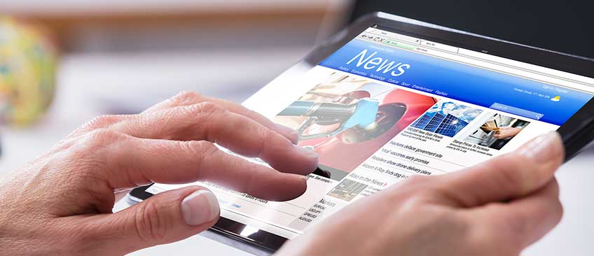 Person reading news on tablet