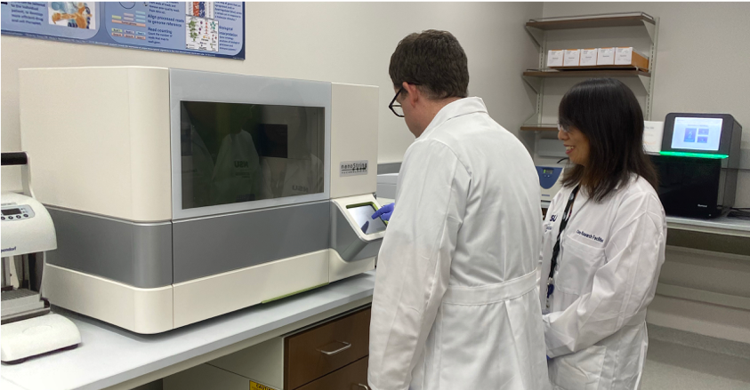 Genomics Technicians using equipment