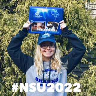 Future NSU student holding acceptance package