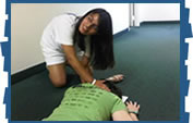 Estelle Saenz practices spine boarding during a summer internship.
