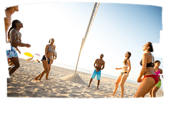 Students enjoying a game of volleyball at the beach