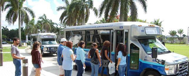 Visitors entering campus shuttle bus